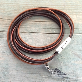 Brown leather bracelet with charm